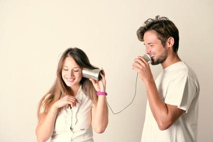 Couple talking through a tin phone
