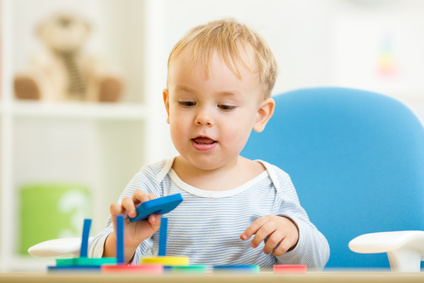 child plays with colorful education color toys